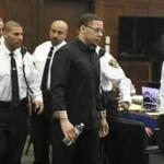 Alexander Bradley enters the courtroom and passes the defense table for his second day of testimony during former New England Patriots football player Aaron Hernandez' double murder trial in Suffolk Superior Court, Tuesday, March 21, 2017, in Boston. Hernandez is on trial for the July 2012 killings of Daniel de Abreu and Safiro Furtado who he encountered in a Boston nightclub. The former New England Patriots NFL football player is already serving a life sentence in the 2013 killing of semi-professional football player Odin Lloyd. (Pat Greenhouse /The Boston Globe via AP, Pool)